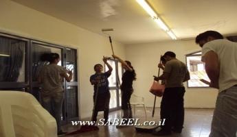 طلاب القيادة الشابَّة في مركز الشبيبة في المغار ينطلقون بأعمال ترميميَّة في بيت المُسن وورشة عمل لذوي الإحتياجات الخاصَّة